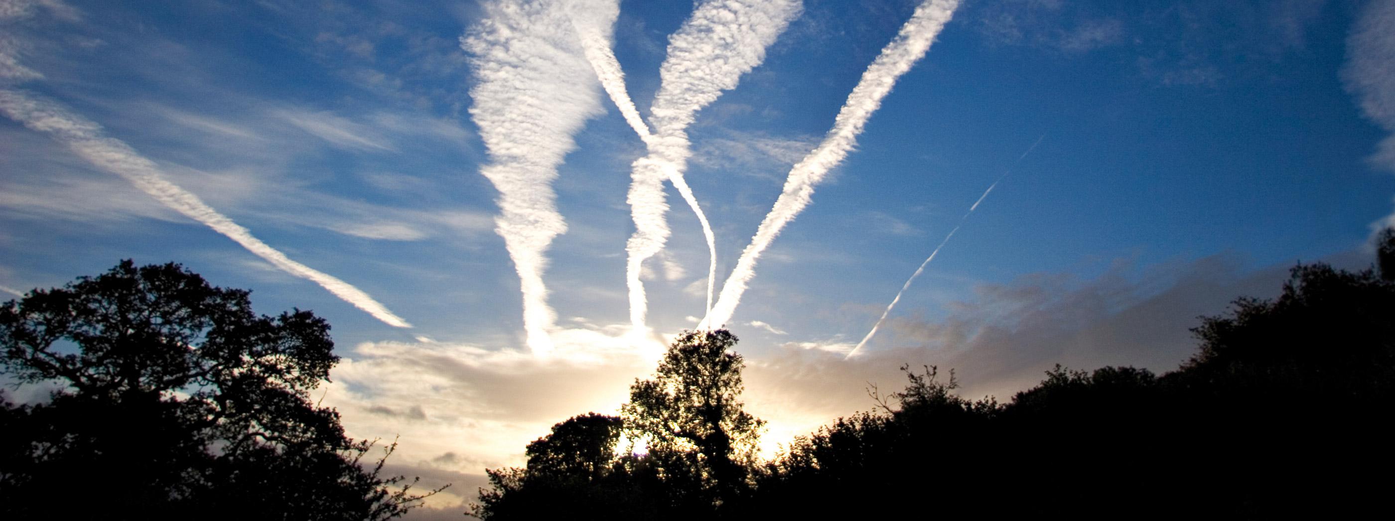 jet trails against a blue sky